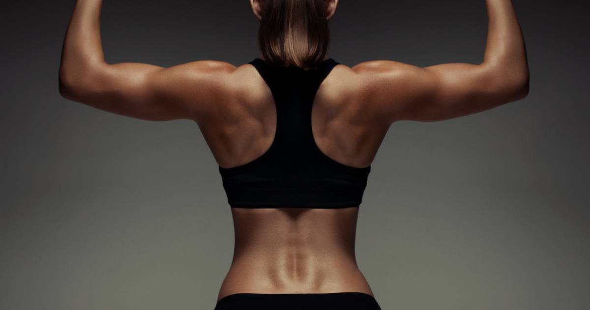 A female flexing her back muscles.