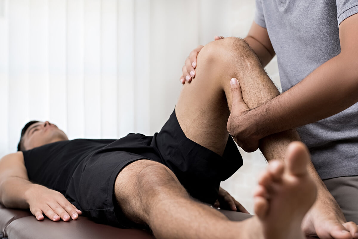 Physical Therapist working on a leg issue with a client.